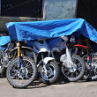 Постер, плакат: Motorcycles of miners on parking at mine