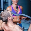 Athlete man in gym with personal fitness trainer — Foto de Stock