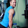 Muscular man exercise in a gym — Stock Photo