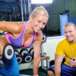 Woman in gym exercise with personal fitness trainer — Stok fotoğraf