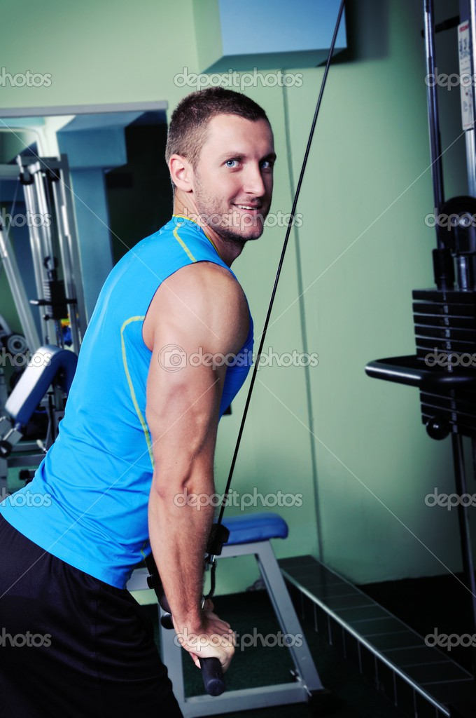 Muscular man exercise in a gym — Stock Photo #12878005