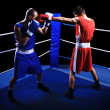 Two male boxers fighting in ring — Stock Photo
