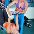 Two beautiful women exercising in gym with weights — Stock Photo