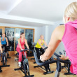 Beautiful women doing exercise in a spinning class at gym — Stock Photo #29885497