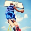 Basketball player in action flying high and scoring — Stock Photo #37564413