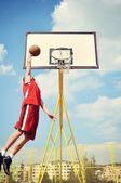 Basketball player in action flying high and scoring — Stok fotoğraf