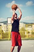 Basketball player concentrate and preparing for shoot — 图库照片