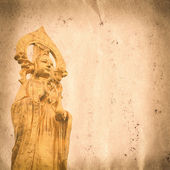 Golden buddha statue old grunge paper texture — Stock Photo