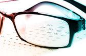 Eye chart and glasses — Stock Photo