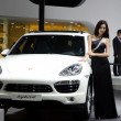 Unidentified model with Porsche Hybrid sport car - Foto de Stock