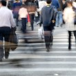 Crowd on zebrcrossing street — Stock Photo #17404423