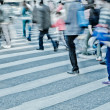 Crowd on zebra crossing street — Stock Photo #17404571