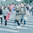 Stock Photo: Crowd on zebra crossing street