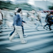 Crowd on zebra crossing street - Stok fotoğraf