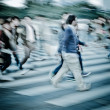 Crowd on zebra crossing street - Stock fotografie