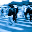 Crowd on zebra crossing street — Stock Photo #17446269