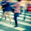 Crowd on zebra crossing street — Stock Photo #17450091