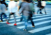Crowd on zebra crossing street — Foto Stock