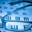 Royalty-Free Stock Photo: Eye chart and glasses