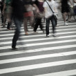 Foto Stock: Walking on big city street