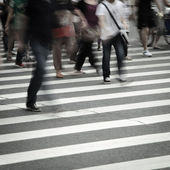 Walking on big city street — Stock Photo