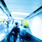 Business on escalator abstract blur — Stock Photo