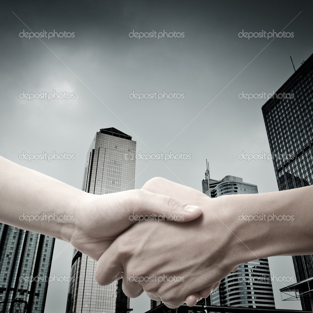 Business handshake on modern city  Stock Photo #18288709