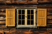 Old wooden window with shutters — Stock Photo
