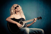 Heavy metal rock star with guitar parody — Stock Photo
