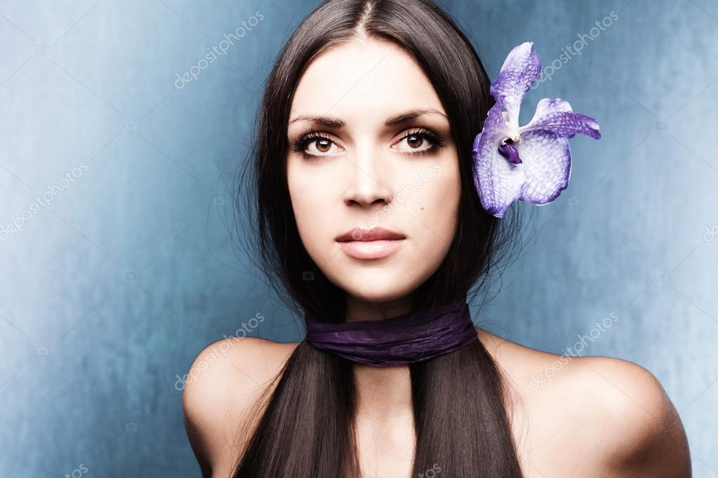 Stylized woman portrait with orchid studio shot  Stock Photo #12644381