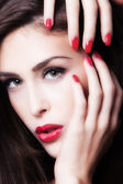 Red lips and nails — Stock Photo