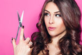 Woman hold scissors — Stock Photo