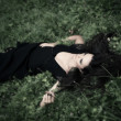 Lie in grass — Stock Photo