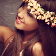 Beauty with wreath of flowers — Stock Photo