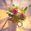 Bouquet of flowers in a cup — Stock Photo