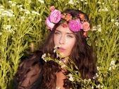 Portrait in flowers — Stock Photo