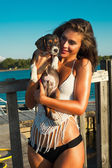 Puppy and girl at seaside — Foto de Stock