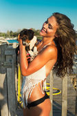 Puppy and girl at seaside — Stock Photo