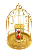 Golden birdcage and hourglass — Stock Photo
