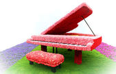 Piano on grass — Stock Photo