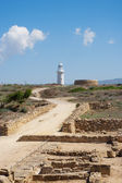 The road to the lighthouse through the ruins — Stock Photo