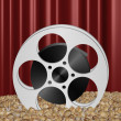 Movie reel in popcorn — Stock Photo