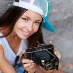 Girl with vintage retro camera having fun playful laughing. — Stock Photo
