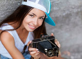 Girl with vintage retro camera having fun playful laughing. — Stock Photo