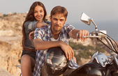 Biker man and girl — Stock Photo
