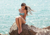 Young, beautiful, sporty and sexy woman relaxing on the beach — Stock Photo