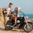 Happy young love couple on scooter enjoying themselves on trip — Stock Photo #30410307