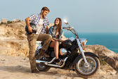 Happy young love couple on scooter enjoying themselves on trip — Stock Photo