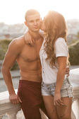 Young beautiful couple in love on sunset — Stock Photo