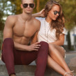 Young couple with sunglasses outdoors — Stock Photo